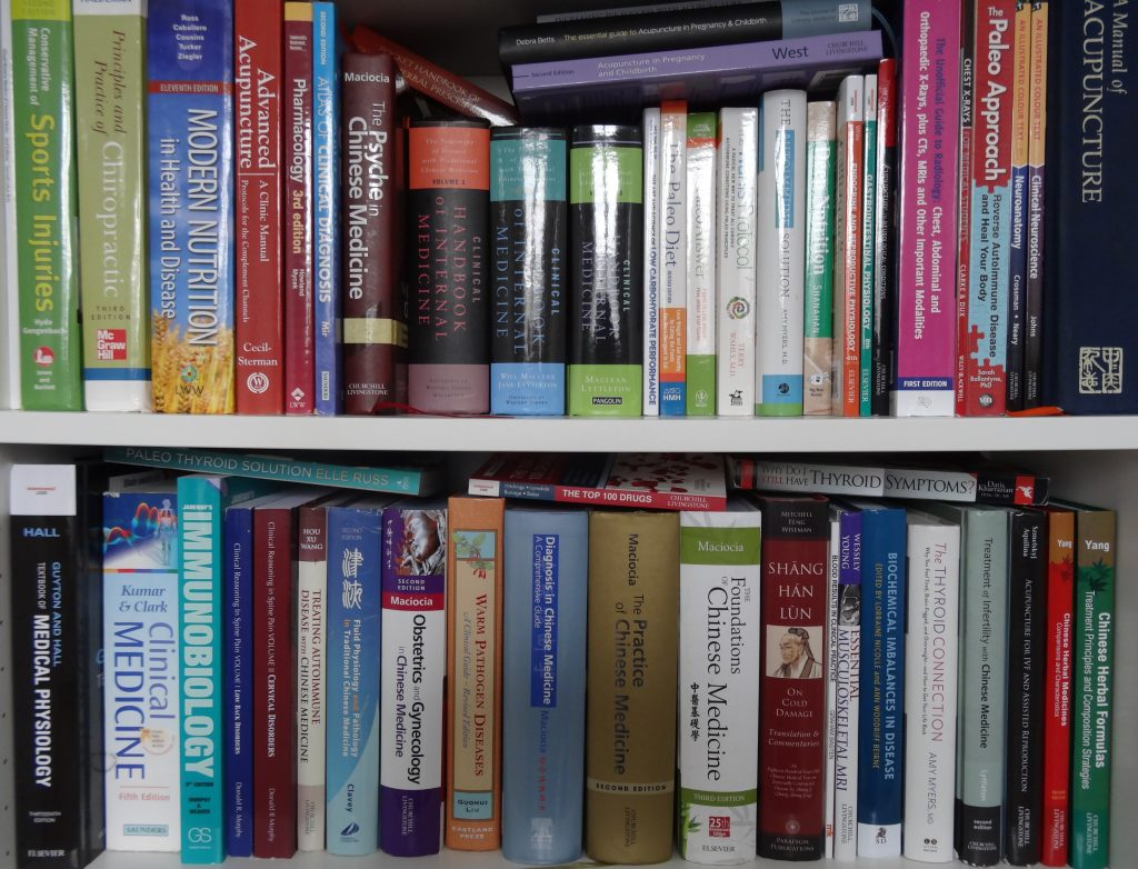 Picture of bookcase with medical books on shelves
