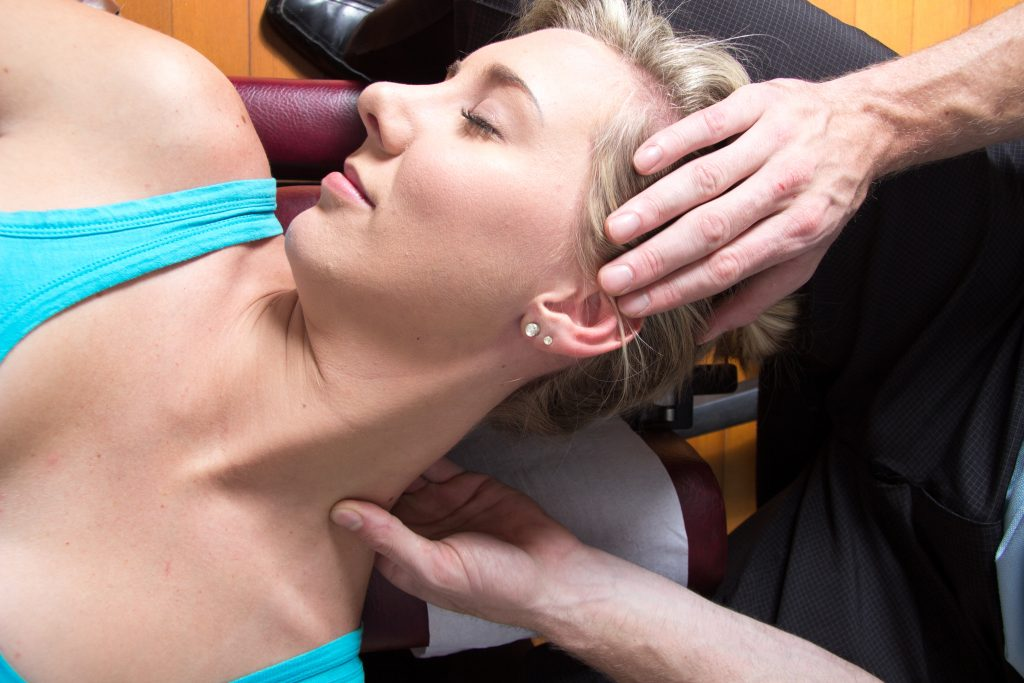 Closeup of female patient neck muscles treatment
