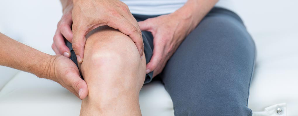 examining patients knee