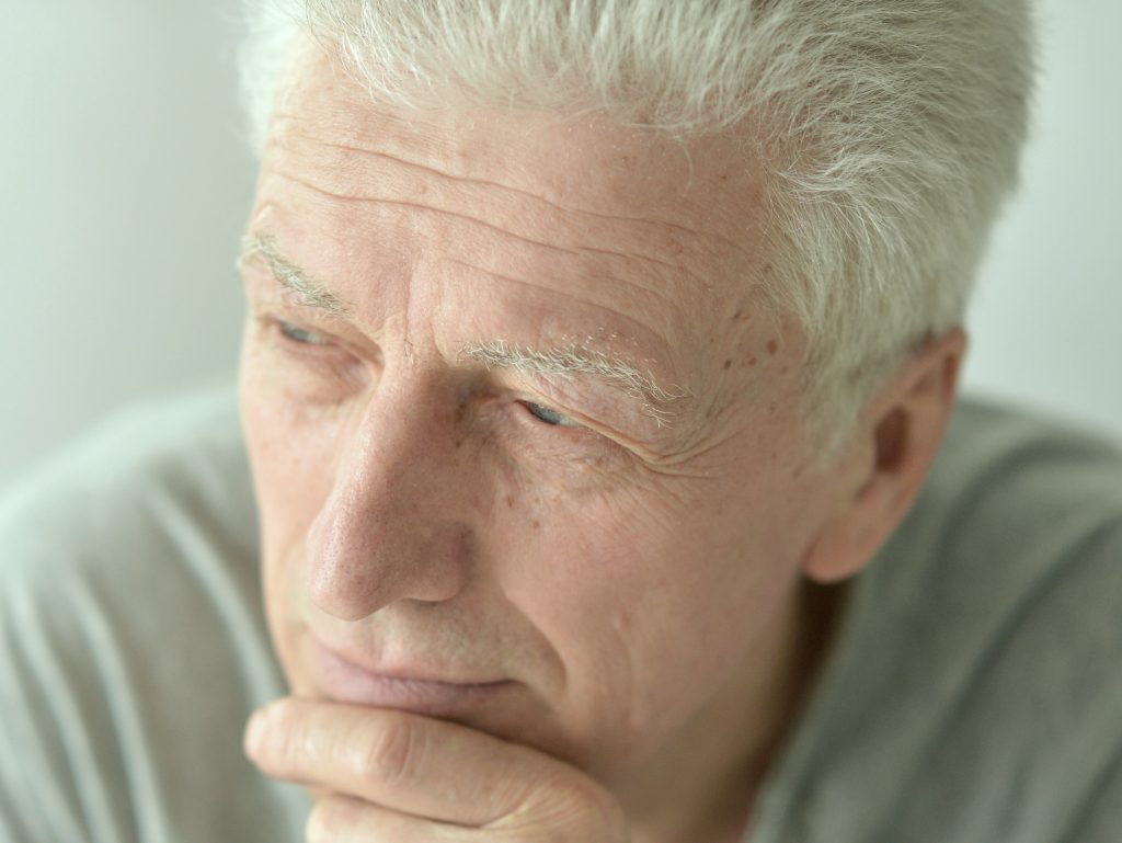 older male person looking pensive