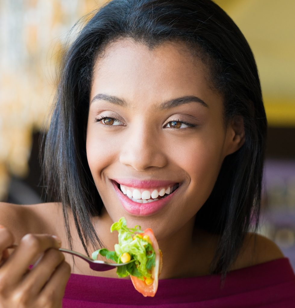 Photo of happy women eating healthy meal