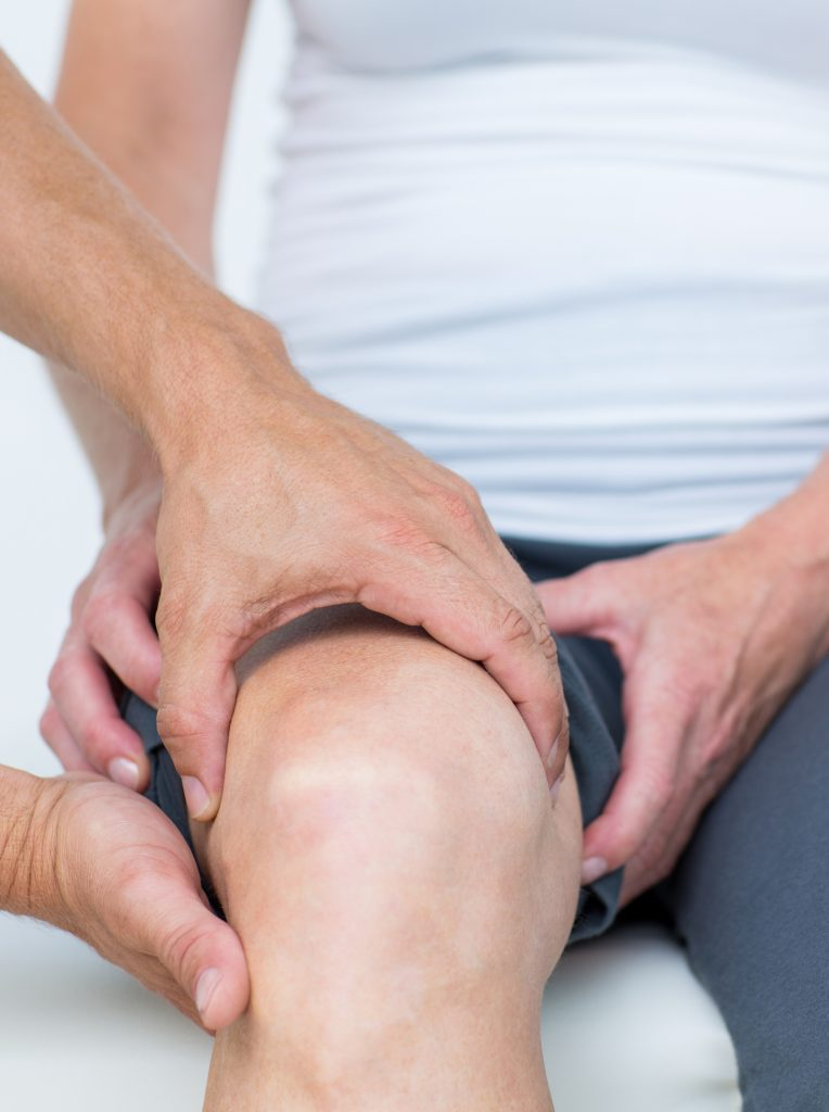 Photo of chiropractor checking knee function