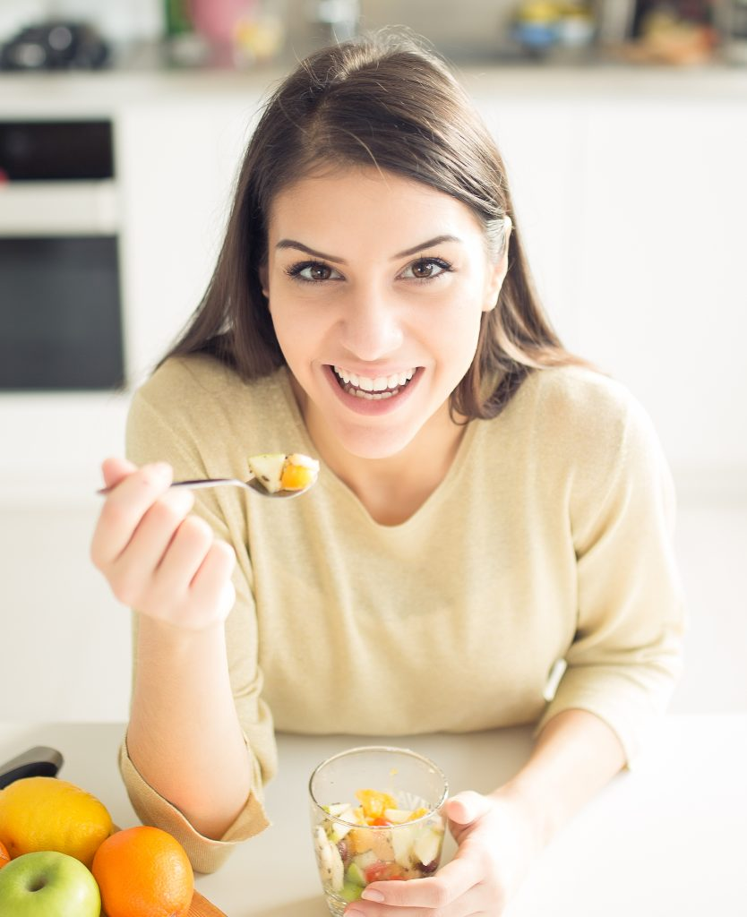 Women eating healthy food without acid reflux