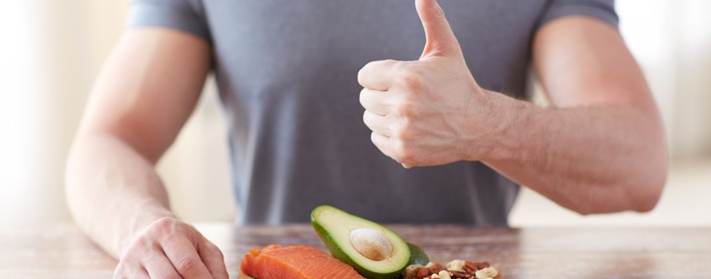 Man giving thumbs up to healthy meal