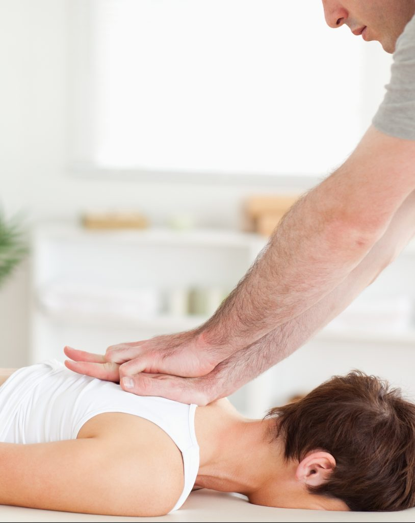 Photo of chiropractor giving treatment to a patient