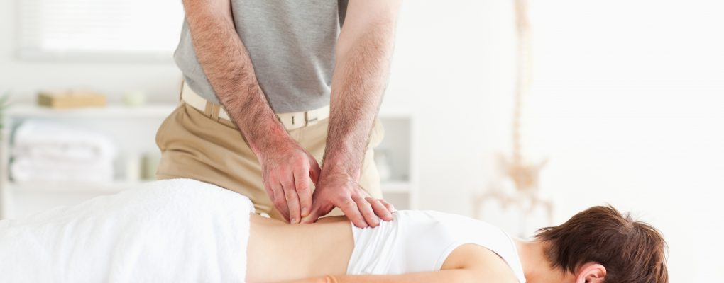 Photo of women receiving chiropractic treatment