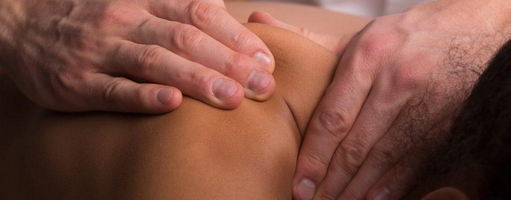 Photo of chiropractor assessing patient's shoulder